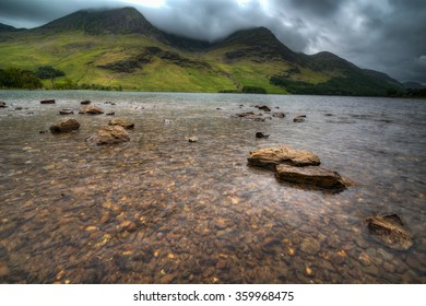 Buttermere Lake in the Lake District in the UK on a cloudy overcast spring day.