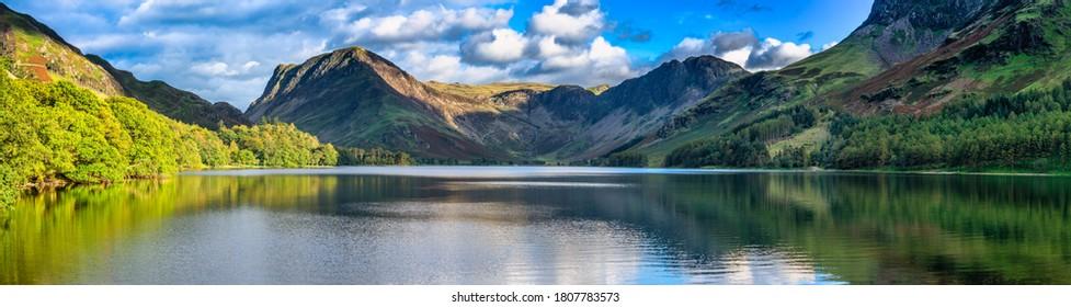 Buttermere lake overlooking Haystacks peak in Lake District. Cumbria, England - Shutterstock ID 1807783573