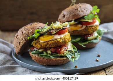 Butternut squash and chickpeas burger with tomato salsa, spinach, roast courgettes and avocado
