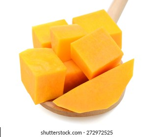 butternut squash chunks on wooden spoon isolated on white