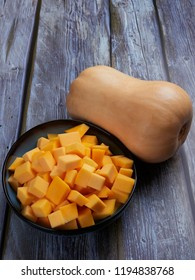 Butternut squash cubes on gray rustic background