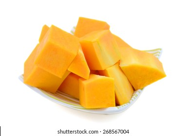 butternut squash cut into chunks on plate isolated on white