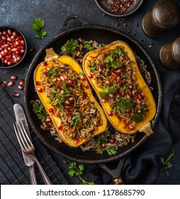 butternut squash stuffed with brown rice and vegetables, served with pomegranate and coriander, top view, square image