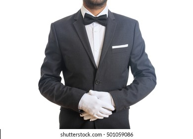 Buttler, waiter with bow tie, ready to serve, standing on white background