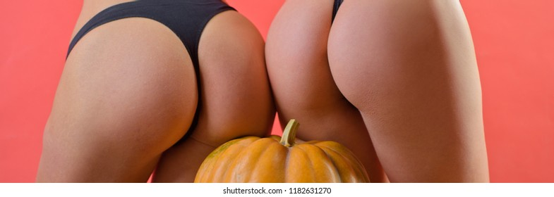 Buttocks ass and pumpkin close-up. Sexy Vampire Woman buttocks. Pumpkin ass. Sexy Halloween art design. Pumpkins isolated on girl with big bum. Trick or treat
