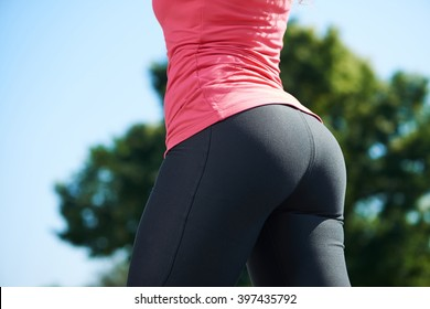 buttocks of fitness girl at park