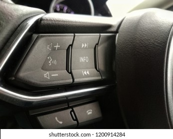 The buttom control on steering wheel. Technology to safe drive while driving.