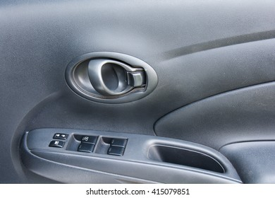 Button in car for adjust windows and lock the door.