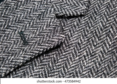 Button hole and lapel on tweed wool jacket, macro, close up,image.