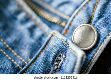 Button on jeans close-up