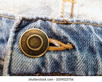 Button through the eyelet