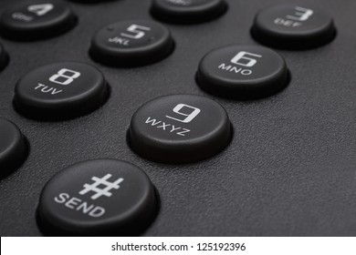 Buttons of black phone closeup