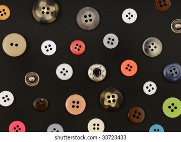 Buttons of different colors on a black background