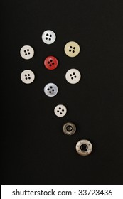 Buttons of different colors shaping a flower
