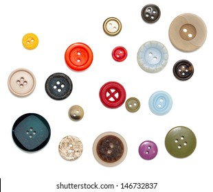 buttons of different size, shape and color over white