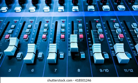 buttons equipment in audio Mixing Console -  Retro style blue tone