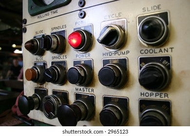 Buttons on a metal working machine.