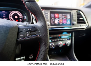 Buttons on steering wheel in a car