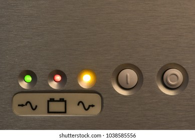 Buttons on uninterruptible power supply