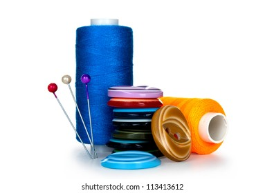 buttons and skeins of thread on white background