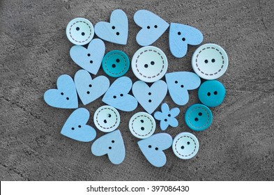 Buttons wooden heart shaped love on a gray background, buttons lot wood, lot of wooden buttons, blue buttons, background of buttons
