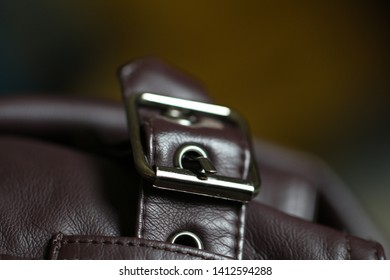 Buttons and zip of the jacket, fabric and leather. It locks two different ends of the clothes