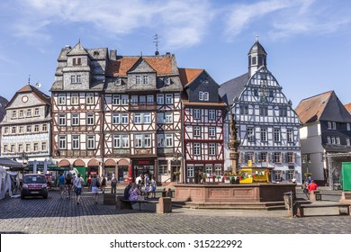 BUTZBACH, GERMANY - JUNE 4, 2015: people enjoy the beautiful medieval market place in Butzbach, Germany. Butzbach is also called the pearl of the Wetterau.