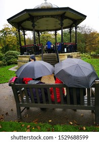 BUXTON, UNITED KINGDOM, 12th October, 2019: A brass band playing music in public in the bandstand in the park in Buxton