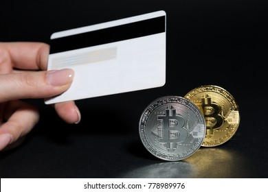 Buy bitcoins online using credit or debit card concept on dark black background