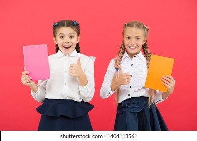 Buy cute stationery for fun studying. Girls famous for obsession with stationery. Girls kids school uniform hold book. Schoolgirl show diary notepad.School supplies concept. School stationery.