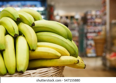 Buy fresh ripe bananas at grocery store.Food market.tasty & healthy nutrition.Vitamin products for health.Banana basket,food shelf aisle.Sale in supermarket shop