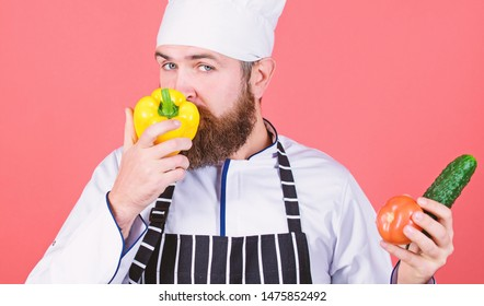 Buy fresh vegetables grocery store. Vegetarian restaurant. Hipster chief chef vegetarian cafe. Choose vegetarian lifestyle. Man cook hat apron hold fresh vegetables. Vegetarian recipe concept.