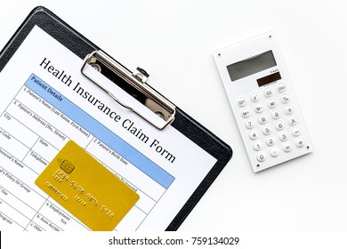 Buy health insurance. Document, bank card and calculator on white background top view