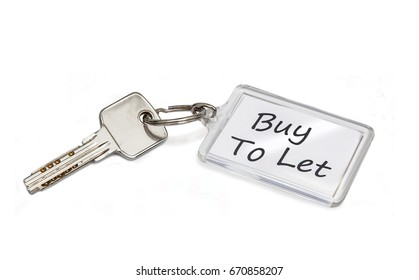 Buy to let concept, house key with keyring