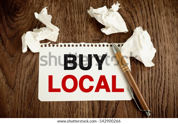Buy Local. Message text written on a note paper