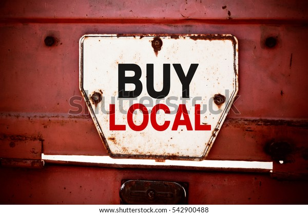 Buy Local. Message text written on a grunge iron signboard