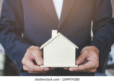 Buy new house concept. Realtor carrying model home.