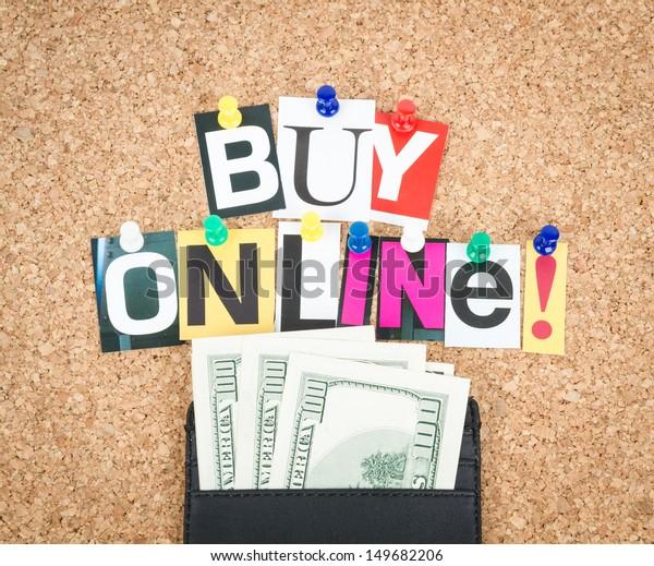 Buy Online, pinned on cork bulletin board, wallet with dollars beside.