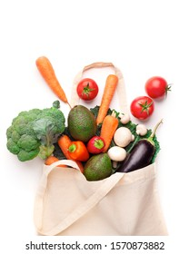 Buy organic. Eco cotton shopping bag with fresh and clean vegetables on white background, copy space