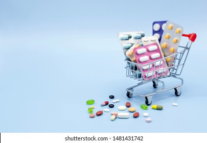 Buy and shopping medicine concept. Various capsules, tablets and medicine in shop trolley on a blue background. Creative idea for health care, health insurance and pharmaceutical company. Copy space. - Shutterstock ID 1481431742