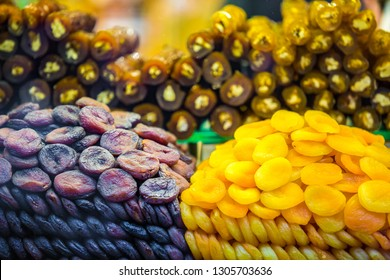 Buy tasty dried apricots and dates in food store. Turkish shop sell delicious fruits for snack