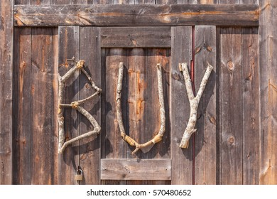 BUY wording made from natural wood on wooden background use for decoration on shop entrance in farmer market, agriculture concept.