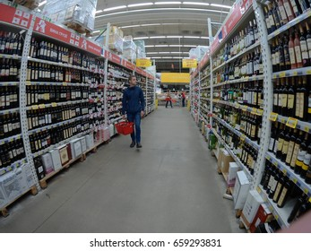 The buyer chooses the goods in one of the supermarkets in Kiev, Ukraine, 06.12.2017