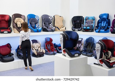 Buyer in the store of children's car seats