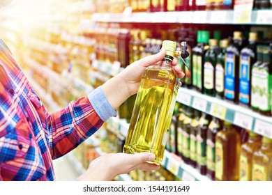 Buyer with the sunflower oil in a store