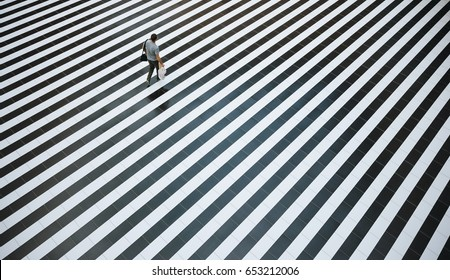 Buyer walks along the black and white floor, the top view