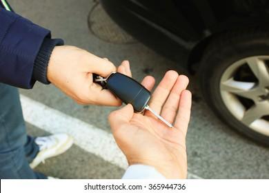 Buyer's hand taking a car key.
