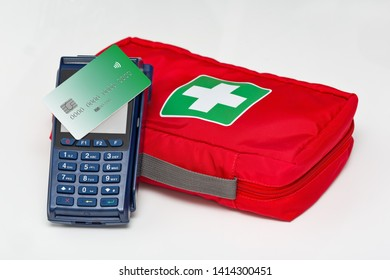 Buying drugs. Modern blue payment terminal and card. First Aid Kit