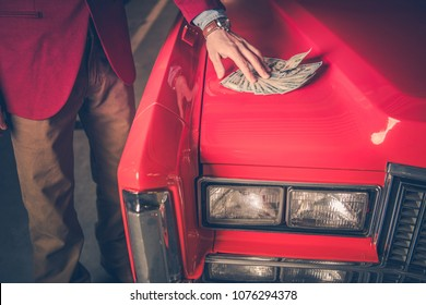 Buying Pre Owned Car. Men Placing Cash Dollars Deposit For the Old Classic Car. Closeup Photo.