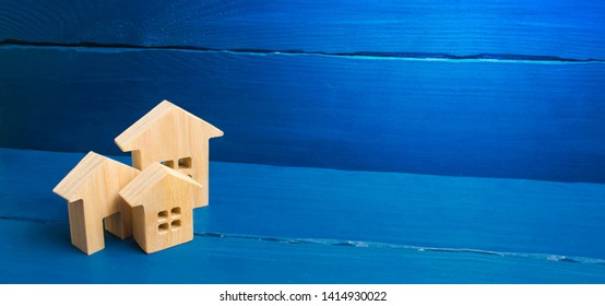 Buying and selling of real estate, construction. Three houses on a blue background. Apartments and apartments. City, settlement. Minimalism. presentations. real estate market. banner, place for text